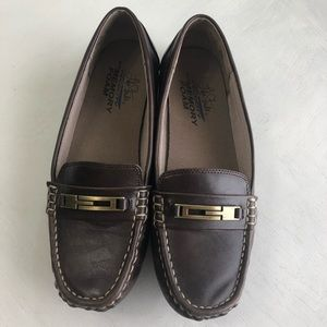 Brown loafers with gold detail